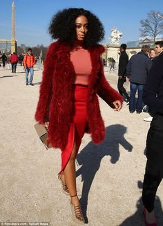 Rouge: The mother-of-one arrived for Carven's presentation in a red faux fur coat, taupe M...