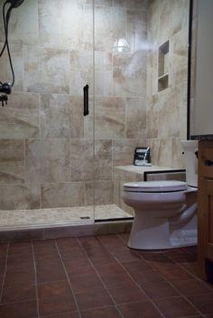 Tiled Shower: Vesale Stone 20x20, Sand; Grout: Mapei, Biscuit; Shower Floor: Vesale Stone 2x2 Mosaic; Sand; Bathroom Floor: Old Castillo Terracotta 6-1/2x6-1/2, Dark Brown; Flooring Grout: Tec Power, Summer Wheat