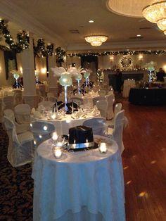 Nye wedding decor. White feathers candles