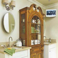 An antique hutch serves as a linen cupboard in the master bath. | Photo: Dominique Vorillon | thisoldhouse.com