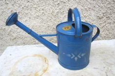 Old painted watering can