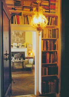 Great book lined entryway. (The Peak of Chic) Carolina Irving in 1993.