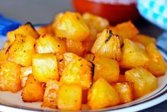 barbecued pineapples diced and served on a plate