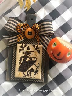 It's all about two if the cutest witches today! From Prairie Schooler Witching hour . Fall Cross Stitch, Cross Stitch Finishing, Cross Stitch Designs, Cross Stitch Patterns, Cross Stitching, Cross Stitch Embroidery, White Christmas Ornaments, Book Page Wreath, Halloween Cross Stitches