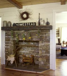love the stone and distressed beam mantle.  Would look good as backing for our woodstove....what would go well under the woodstove though?