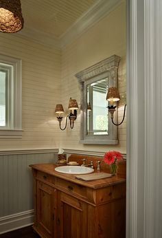 Bathroom. Coastal Inspired Bathroom Design. I am loving the sconces and the beadboard walls in this coastal bathroom. #Bathroom #coastal #interiors