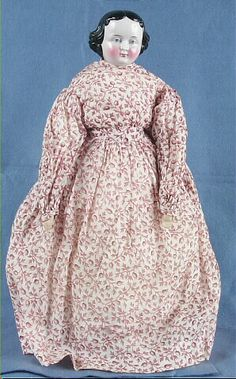 China doll, woman, brown and white print dress, Germany, 1855-1860. Wisconsin Historical Society. www.wisconsinhistory.org