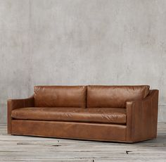RH's Petite Belgian Classic Slope Arm Leather Sofa:A classic interpretation of the European-inspired slope arm sofa. Low to the ground, deep in profile and sleekly streamlined for casual yet sophisticated appeal, it offers luxurious comfort.