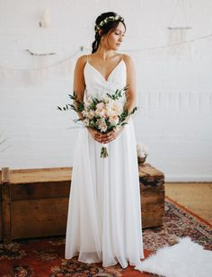 A beautiful white gown with a slightly flowing skirt, and bared shoulders - that make her look like a Grecian goddess.