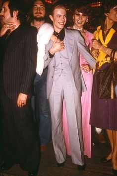 David Bowie at Studio 54 70s fashion icon suit pink dress