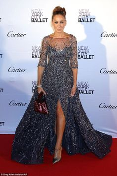 Sarah, 50, showed a little of her bronzed legs in the gown which showed off her metallic shoes