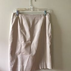 Beige skirt Beige knee length skirt with back spilt. White House Black Market Skirts