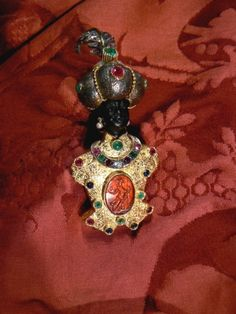 Blackamoor wi Diamonds Rubies Coral and other precious stones