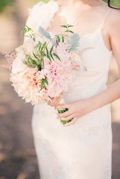 #Bouquet #Dahlias | See the full wedding on SMP -  www.StyleMePretty.com/2014/01/22/vineyard-wedding-at-crossroads-estate/ Honey Honey Photography