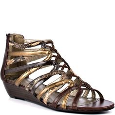 Krunchtime - Brown Snake  You won't have much time to pick up this utterly cute gladiator sandal! Krunchtime gives you a brown synthetic upper with snake printed and elastic straps at the vamp. A zipper in the back and 1 inch slight wedge heel completes this daring look.  $44.99