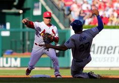 ST LOUIS, MO - OCTOBER 07: Matt Kemp #27 of the Los Angeles Dodgers slides into second as Kolten Wong #16 of the St. Louis Cardinals turns a double play in the second inning in Game Four of the National League Divison Series at Busch Stadium on October 7, 2014 in St Louis, Missouri. (Photo by Dilip Vishwanat/Getty Images)