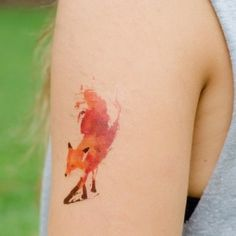 Watercolor Fox Tattoo - I saw one in blue as well so maybe it could be a couple thing! One of you is the fire and the other the calm..... You would have the others fox on you
