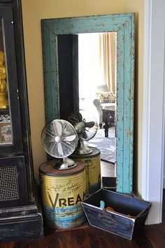 diy mirror? love the turquoise and antiques
