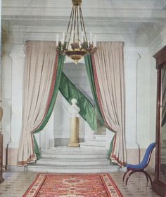 Silken curtains frame a doorway at Christian Dior's house, 7 boulevard Jules-Sandeau in Paris; green silk flutters up the balustrade, softening the stone ascent. The house (now demolished) was decorated by Georges Geffroy and Victor Grandpierre. Christian Dior, Framing Doorway, Parquetry Floor, Dressing Room Closet, Textiles, Celebrity Houses, Entrance Hall, Easy Home Decor, Home Look