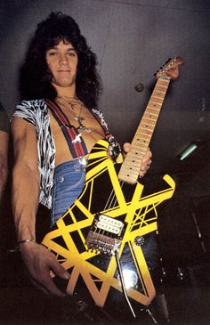 "This is the story of why Dimebag's last words were ""Van Halen!"", and how he was buried with the guitar that inspired him most — Eddie Van Halen's yellow and black striped Charvel hybrid guitar featured on the back cover of Van Halen II."