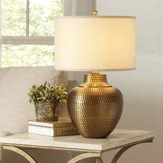 Kaden Table Lamp | Featuring a hammered antique brass base and natural-colored, hardback fabric shade to give this loft-style light a universal appeal.