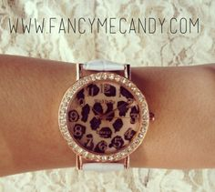 Cheetah print watch with white or black band.