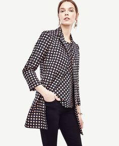 Impeccably tailored, this stylish topper delivers a dose of graphic refinement…