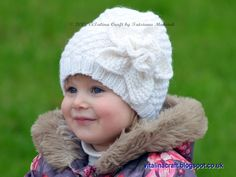 This beautiful knitted hat is a perfect accessory for the cold winter days. It is knitted with beautiful daisy pattern and decorated with large knitted flower. The hat is knitted in the round with Aran weight wool yarn in white color. The knitting pattern is easy to follow and suitable for intermediate knitters. It contains row–by-row instructions and photo-tutorial for the flower assembly.