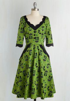 Rain or shine, you'll be looking all kinds of vintage-inspired fine after you don this printed, avocado green midi! Touting coquettish kitties, daisy-adorned umbrellas, and petite precipitation-centric patterns - plus scalloped trim and perfect pockets - this dress makes for one enticing ensemble!