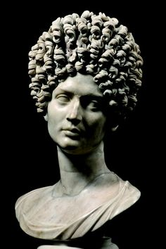 Ancient Roman hairstyles were not wigs, but were actually natural hair held in place by needles & thread. Around the 1st century of the Common Era, Roman women would have servants or slaves dressing their hair. Using such a technique was an ingenious way to create intricate hairstyles. One of the benefits of sewing hair is that it stays firmly in place because of the thread. Additionally, the thread can easily be hidden from sight within the hair.