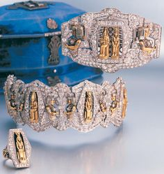 A rare Art Deco Egyptian revival diamond bracelet, brooch and ring, circa 1920. The art and artefacts of Ancient Egypt have long been a source of fascination and inspiration to Western jewellery designers but it was not until the discovery of the Tomb of Tutankhamen in 1922, which sparked worldwide media frenzy, that a trend became a mania. #ArtDeco