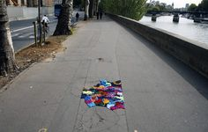 YARN POTHOLE ART IN PARIS; With colorful strips of yarn Juliana Santacruz Herrera decided to decorate Paris' potholes. Randomly placed in cracks and breaks it creates a fun and colorful change in the landscape contrasting with the decrepit cement.