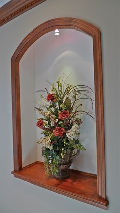 Lighted niche and floral arrangement