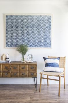 A handmade textile is a work of art whether you hang it on the wall or not, so go ahead and put a favorite fabric in a frame. The block-printed fabric above was handmade in India and can be bought on Loomology, or you can DIY your own by choosing a fabric and displaying it in a lucite frame.