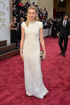 Naomi Watts dressed in a custom white-beaded Calvin Klein Collection gown and Bulgari jewels at the 2014 Oscars