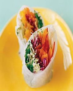 As rich in color as in flavor, these spring rolls (dip 'em in peanut sauce) pack healthy ribbons of carrot, daikon radish sprout, cabbage, pepper, mint, basil, and cilantro. #hellennicdesigns #appetizers #weddingplanning #cocktailhour #weddingreception