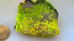 Phurcalite and Autunite  Locality: Senhora da Assunção Mine, Aldeia Nova, Ferreira de Aves, Sátão, Viseu, Portugal  Description: Phurcalite (canary yellow spherules) and Autunite (yellowish green crystals) on quartz. The specimen shows clearly the difference between the two mineral species, Cesar M. Salvan