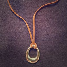 Premier Designs Teardrop Necklace Leather strap and silver tone teardrop necklace from Premier Designs. The pendant is removable. Good condition. There are a few marks on the edge of the pendant. Comes with plastic Premier Designs baggie. Premier Designs Jewelry Necklaces