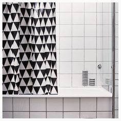 Add some cool black and white geometric patterns to your bathroom's decor.Ferm Living's Triangle Shower Curtain is an exciting bath accessory. Unlike many othe