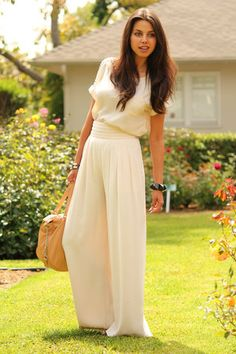 perfect 70's look: wide leg jumpsuit with long, natural hair