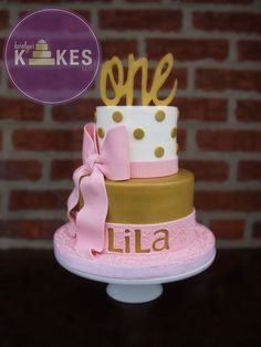 Pink and Gold girly first birthday KAKE! Top cake is iced in buttercream. Bottom tier is covered in Marshmallow Fondant (MMF). MMF ribbons, bow and topper.