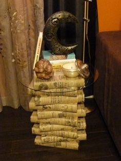 Took my useless set of Encyclopedia, covered them with a paper I liked. Stacked them all, and put a round glass top I already had, to top it off...Cute side table...on the cheap..