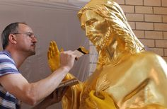 Gold leaf gilding on bronze. Work in progress.