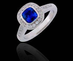 Blue Sapphire and diamonds ring .