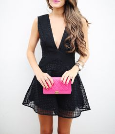 black lace romper with pink clutch