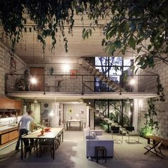 The industrial look of this real home, designed by architect Terra E Tuma, undergoes a beautiful softening effect from the introduction of some natural beauty.Would love to live here, any day!