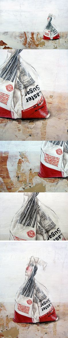 'Sugar' depicts an opened bag of fine white crystals, left on a dirty, scuffed surface.
