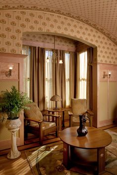 Mableton's Master Sitting Room is part of a suite of rooms that also includes the Master Bedroom and Master Bath. This suite of rooms departs from the Victorian styles that characterize the rest of Mableton's interiors by introducing Arts and Crafts themes with elements of Art Nouveau.  A tall maple wainscot with bird's eye and densely patterned wallpaper insets provides sets off the bold scale of the wallpaper patterns on the upper walls and ceiling in this sunny interior…