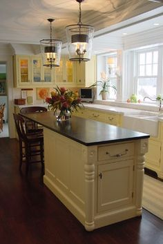 platinum kitchens: kitchens. island with seating in narrow kitchen