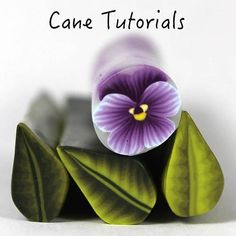 Polymer clay pansy cane tutorial. Includes water drop cane and hibiscus flower.